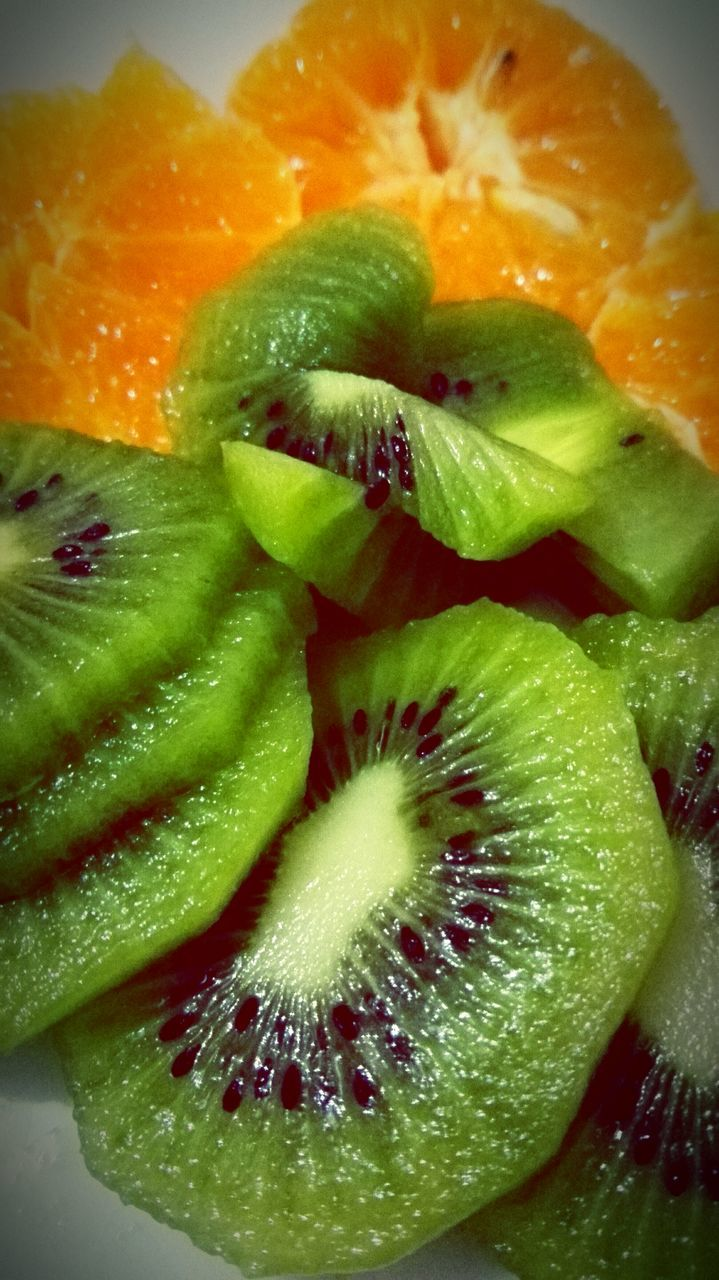 fruit, healthy eating, freshness, slice, food, food and drink, kiwi - fruit, cross section, close-up, kiwi, halved, ripe, no people, indoors, green color, citrus fruit, full frame, grapefruit, ready-to-eat, blood orange, day