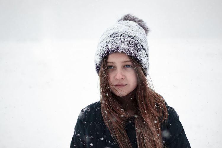 Portrait of beautiful young woman in snow