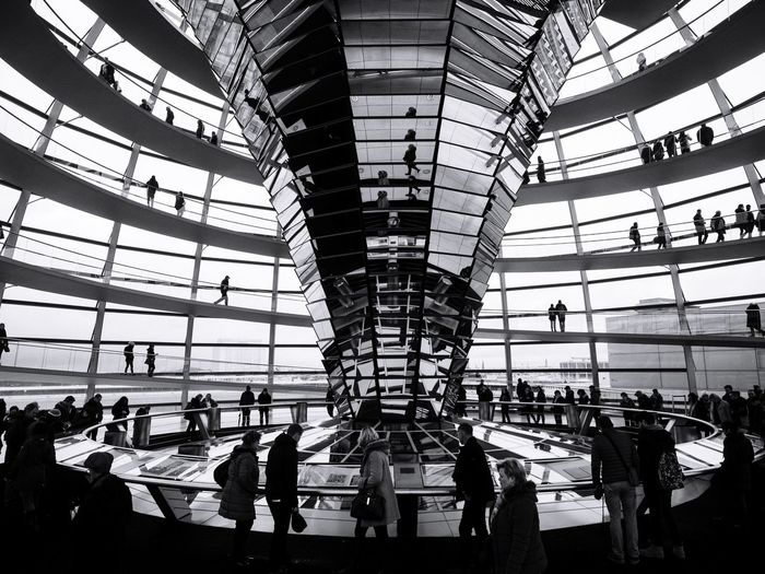 Travel Monochrome Real People Streetphotography Men Blackandwhite Built Structure Dome Indoors  Travel Destinations Women Architecture Passenger Day Public Transportation Modern Sky Cultures People Adults Only Capture Berlin Urban Geometry Berlin Germany ReichstagBuilding