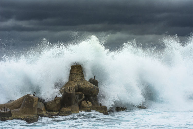 Storm hitting the barrier Storm Coast Seascape Waterfront Water Sea Power In Nature Force Rushing Crash Hitting Wave Ocean Tide Surf Crashing