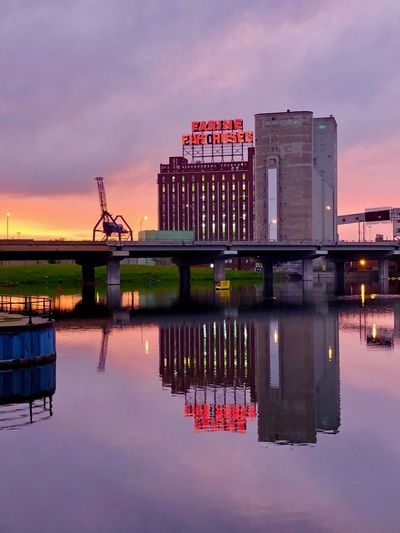 Farine Five Roses Farine Bakery Usine Five Roses Sunrise Reflection Water Sky Built Structure Architecture Building Exterior Waterfront Nature Cloud - Sky Illuminated No People City River Outdoors Building