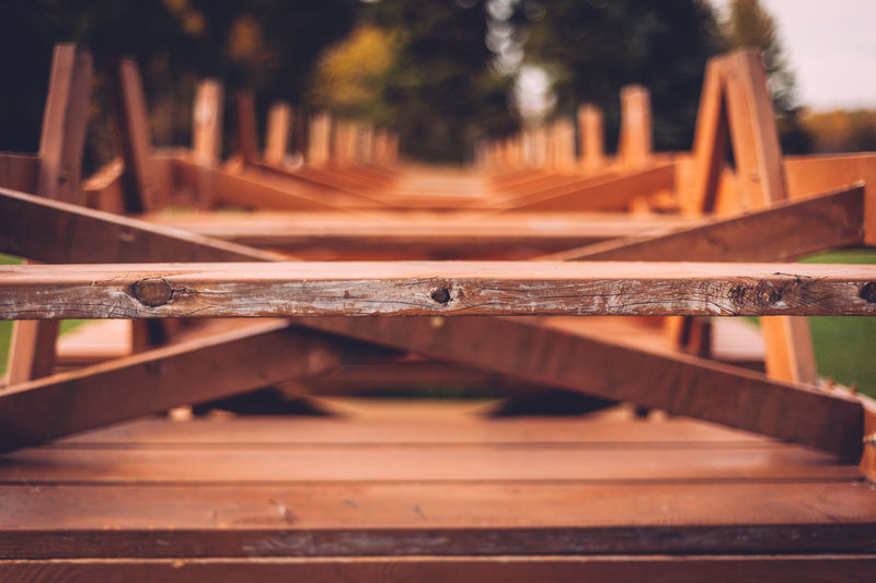 Close-up Depth Of Field Focus On Foreground Picnic Tables Selective Focus Stacked Wood - Material Wooden