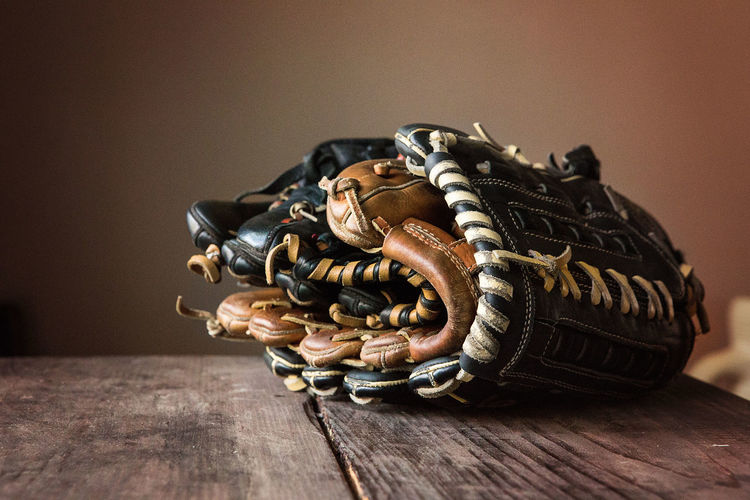 Leather baseball gloves on table