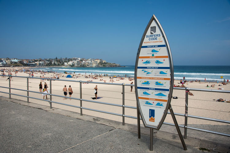 SYDNEY,NSW,AUSTRALIA-NOVEMBER 21,2016: Crowds at Bondi Beach, with Surfers Code rules sign, on the Pacific Ocean coast of Sydney, Australia Australia Respect Rules Sign Beach Blue Bondi Code Crowd Day Etiquette Guidelines Large Group Of People Leisure Activity Nature People Relaxation Scenics Sea Sky Sport Surfers Sydney Water Wave