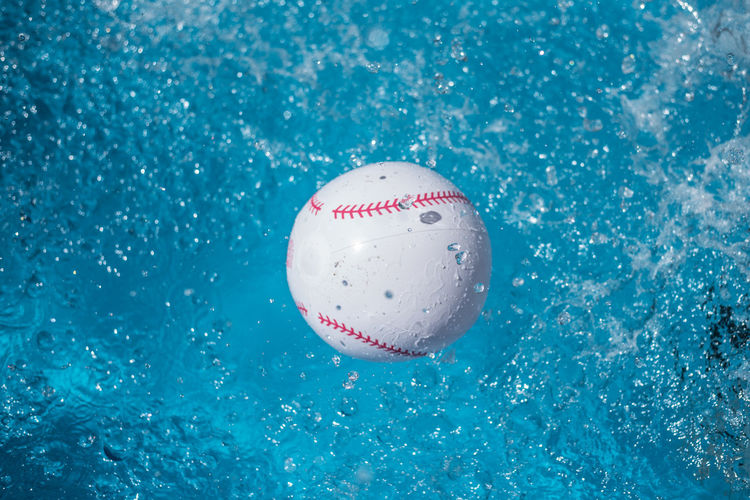 High Angle View Of Wet Ball Over Swimming Pool