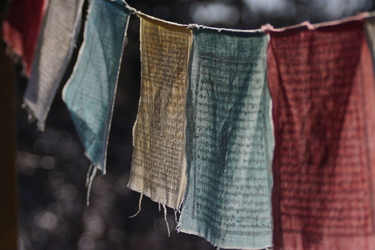 Close-Up Of Torn Prayer Flags