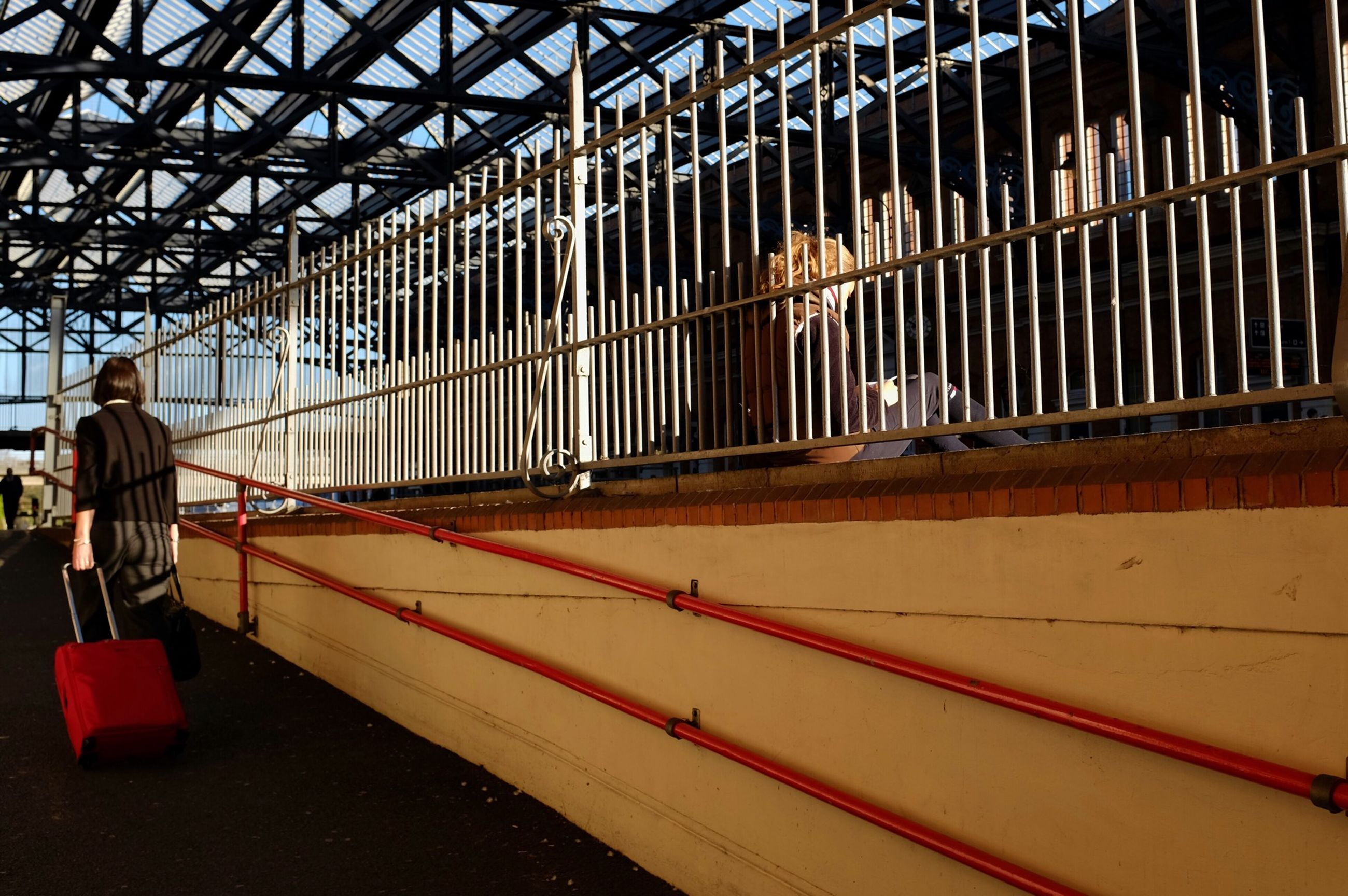 metal, railing, transportation, built structure, men, architecture, mode of transport, metallic, domestic animals, indoors, incidental people, lifestyles, day, animal themes, land vehicle, fence, travel, leisure activity, walking