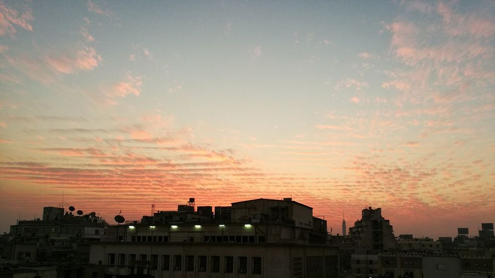Sunset Sky Building Exterior City Architecture Cloud - Sky Built Structure Dramatic Sky Silhouette Outdoors No People Cityscape Beauty In Nature Urban Skyline Nature City Downtown Cairo Egypt Adapted To The City Color Contrasts Nofilter Contrasts Pattern The City Light