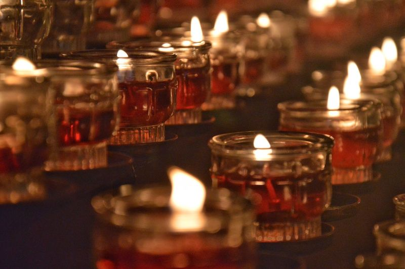 Close-up of tea light candles in temple