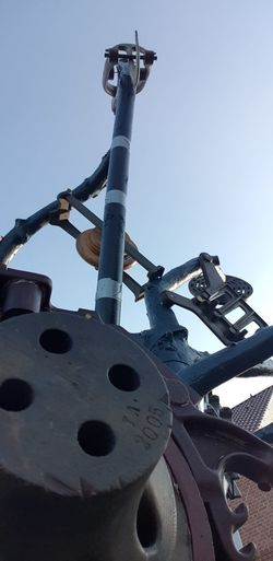 Low angle view of machinery against sky