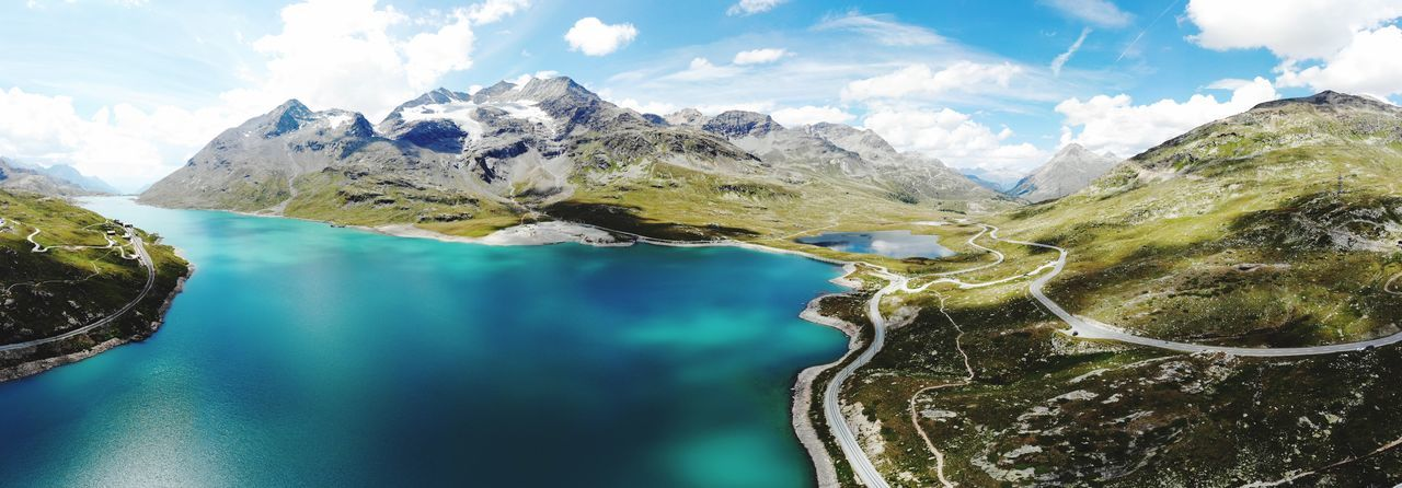 Drone shot from the swiss alps. Mountain Lake Mavic Poschiavo Passstrasse Swiss Mountains Swiss Alps Lago Bianco Bernina Graubünden Dronephotography Panorama EyeEm Selects Water Scenics - Nature Mountain Beauty In Nature Cloud - Sky Tranquility Mountain Range