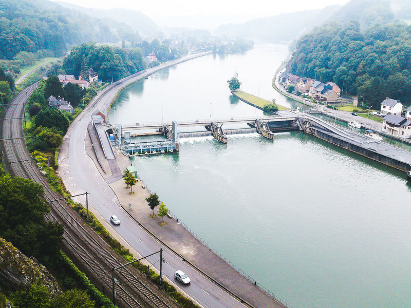 Beautiful Nature Belgium Bridge - Man Made Structure Built Structure Canal Climbing Spot Countryside Engineering Green Color Meuse Mountain Nature No People Outdoors River Scenics Sluice Tide Gate Tourism Tranquility Misty Morning Trees Water Copy Space Scenic View Flying High