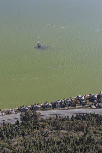 Aerial view of houses by polluted dian lake