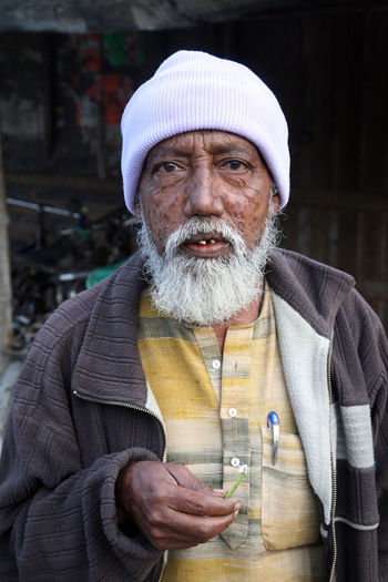 Portrait of a day laborer January 14, 2009 in Kumrokhali, West Bengal, India. Adult ASIA Beard Face HEAD Headshot Hindu India Kumrokhali Laborer Look Male Men Person Poor  Portrait Poverty Rural Street Village West Bengal Work Working
