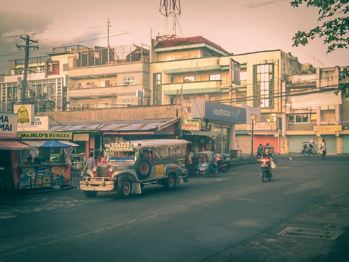 Street Photography Street Photography Kalye Jeepney Transportation City Mode Of Transportation Street Architecture Land Vehicle Building Exterior Road Motor Vehicle Car Built Structure City Street Men Sky Outdoors Real People