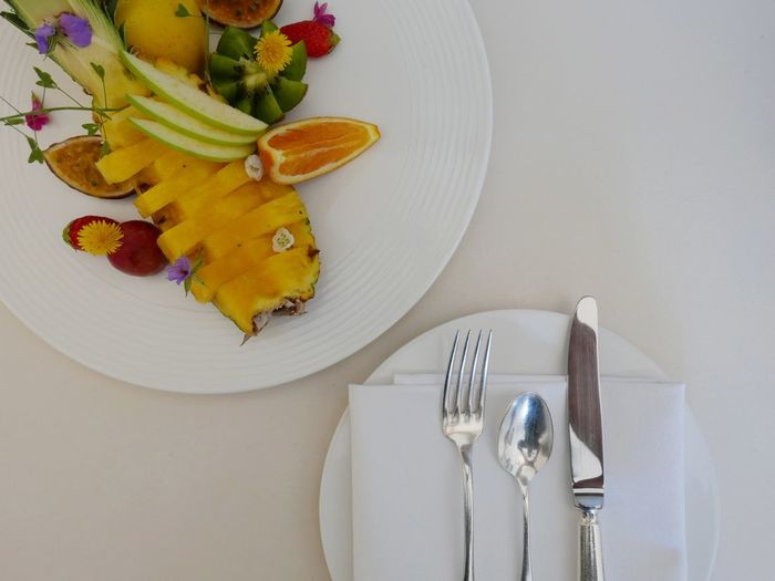 Table set with a nicely designed fruit plate At Table Table Setting Fruits Cutlery Mealtime