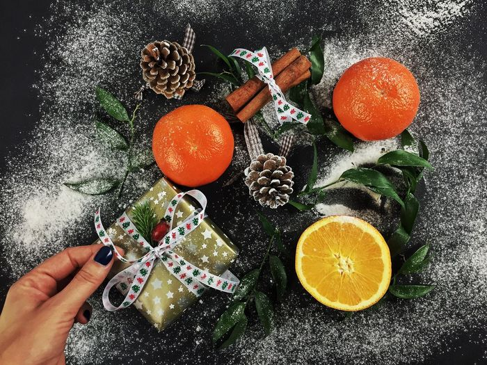 Close-up high angle view of gift box and oranges