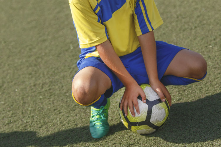 soccer / football Boys Childhood Day Grass Human Leg Leisure Activity Lifestyles Low Section One Person Outdoors Playing Real People Soccer Soccer Ball Soccer Field Soccer Player Soccer Uniform Sunlight