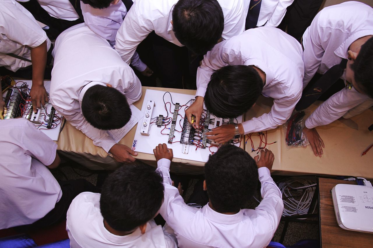 High angle view of students working in classroom