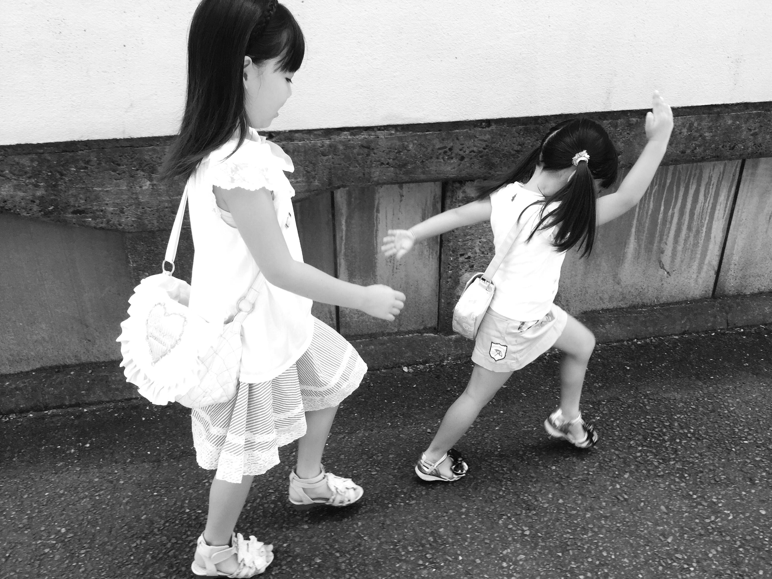 childhood, full length, elementary age, casual clothing, person, lifestyles, boys, girls, cute, leisure activity, innocence, holding, playing, standing, happiness, street, front view, playful
