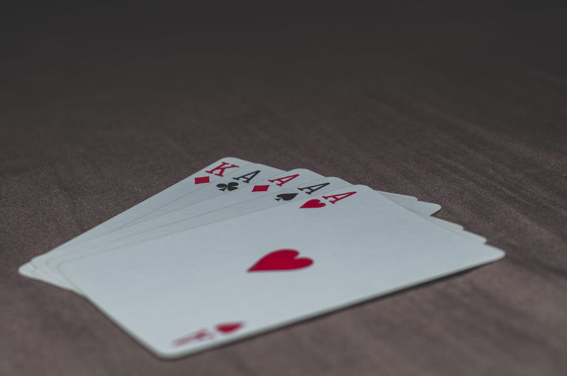 Poker Arts Culture And Entertainment Cards Close-up Competition Gambling Game Of Chance Heart Shape High Angle View Indoors  Leisure Activity Leisure Games Luck Nightlife No People Opportunity Poker - Card Game Red Relaxation Still Life Success Table