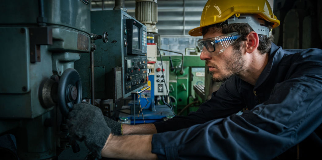 Male engineer working in an industrial factory. concept industry.