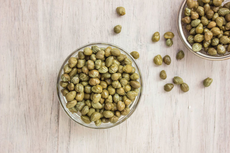 Caper, Food, Food and Drink, Ingredient, Marinated Background Bowl Caper Capers Close-up Day Food Food And Drink Freshness Healthy Eating Indoors  Ingredient No People Spice Wood - Material