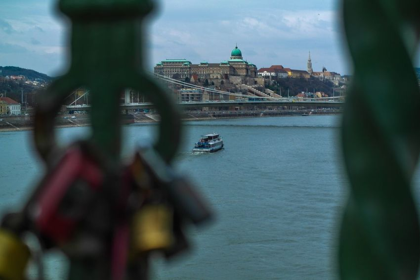 Budapest - March 2016 Fence Bridge Locks Of Love Locks Europe Hungary Budapest Architecture Built Structure Focus On Background River Building Exterior Water Bridge - Man Made Structure Transportation Sky Travel Destinations Day No People Mode Of Transport City Outdoors Nautical Vessel
