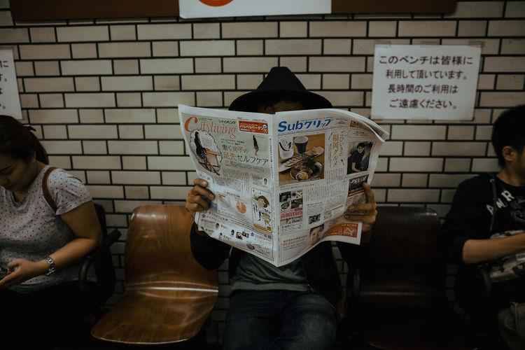 Japan Newspaper Subway People Text