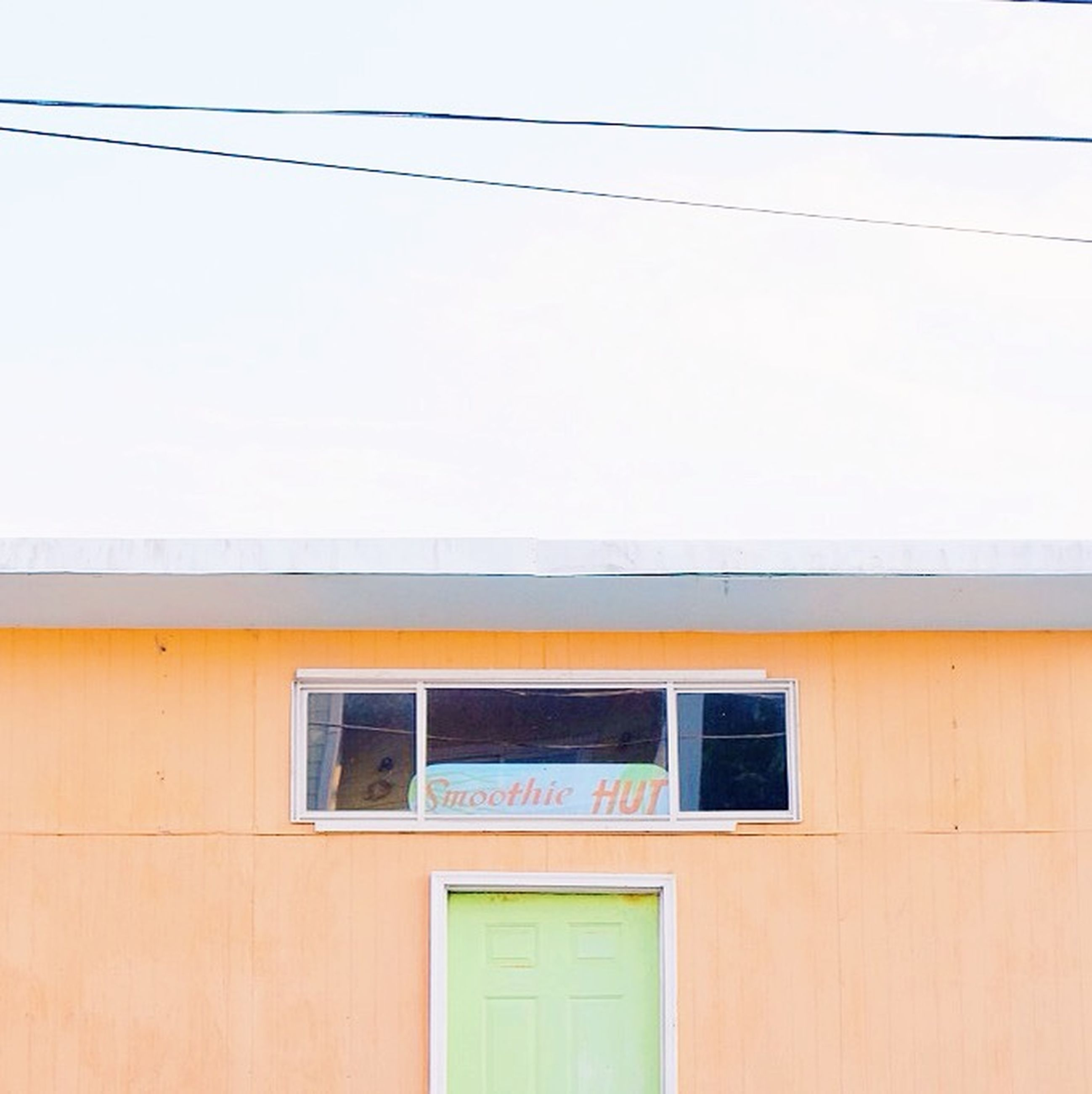 architecture, built structure, building exterior, window, cable, wall - building feature, low angle view, power line, yellow, wall, building, house, residential building, residential structure, day, no people, indoors, clear sky, glass - material, copy space