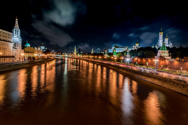 High angle view of moskva river with colorful lights reflection at night