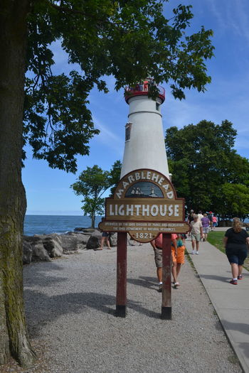 Lighthouse Marblehead Lighthouse Marblehead, OH Lighthouse Architecture Built Structure Day Full Length Nature Outdoors People Real People Sky Tree Water Women