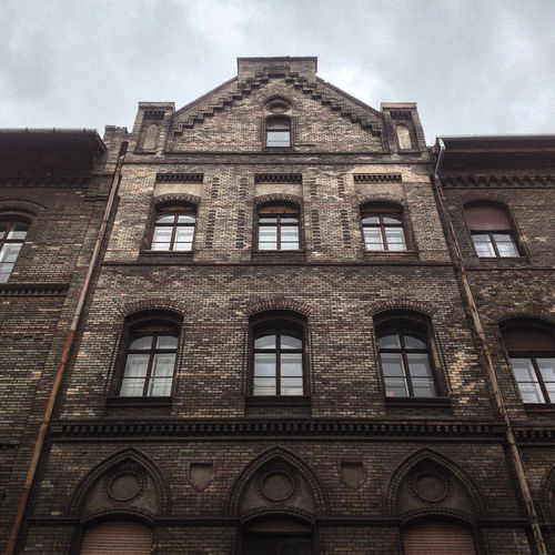 Architecture Brick Wall Budapest Building Building Exterior Built Structure Cloudy Culture Downtown Exterior Historic Low Angle View No People Outdoors Overcast Residential Building Residential Structure Sky Window