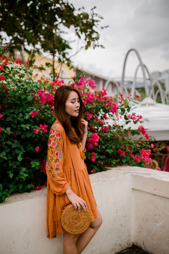 bloom where you are planted Portrait Of A Woman Portrait Photography Portrait City Life Flower Flowers Flower Only Women One Person Young Adult One Woman Only Young Women Beauty Beautiful Woman One Young Woman Only Lifestyles Outdoors Nature Beautiful People Multi Colored