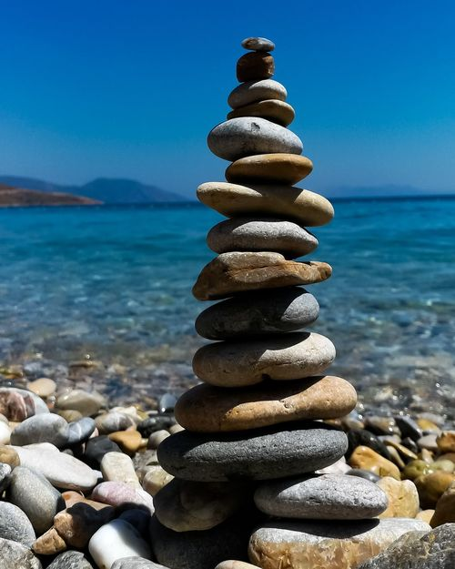 Equilibrium EyeEm Selects Water Sea Beach Stack Pebble Balance Rock - Object Stability Arrangement Sand Stack Rock
