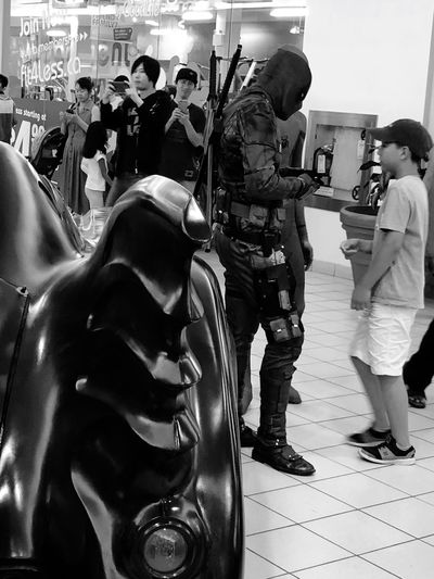 Indoor Photography series: Deadpool at Local Comic Con Event Comic Con Indoor Photography Black And White Photography Deadpool Costume Group Of People Real People Men Full Length People Adult Women Standing Group Medium Group Of People Mode Of Transportation Arts Culture And Entertainment City Indoors  Leisure Activity Day EyeEmNewHere
