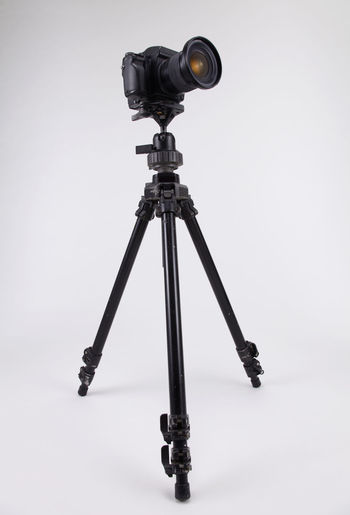 studio shot of high end digital camera on the tripod Camera Photography Multimedia Expertise Professional Occupation Tripod Photograph DSLR Lens Equipment Photographic Theme Photographing Black Nobody White Background SLR Camera Photography Themes Technology Studio Shot Camera - Photographic Equipment Indoors  No People Still Life Photographic Equipment Close-up Digital Camera Copy Space Single Object High End Medium Format Black Color Gray Gray Background