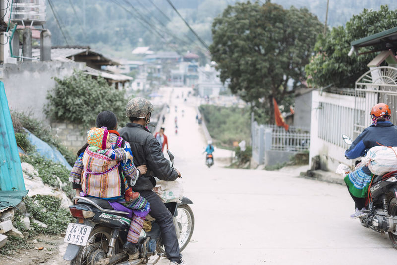 Going home after the Bắc Hà Sunday market, Vietnam ASIA Asian Culture Baby Bac Ha Bike Family Focus On Foreground Going Home Motorbike Motorcycles On The Way On The Way Home Traditional Traditional Clothing Traditional Culture Transportation Travel Travel Destinations Travel Photography Vietnam Wanderlust