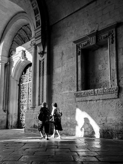 """""""se détendre"""" Series of a street photography project that focusing on the Maltese people. Shadow Light And Shadow Shadows & Lights Blackandwhite Trip Vacation Holiday Streetphotography Maltaphotography Black & White Blackandwhite Photography Project Street People Friendship Friends Old People Old Friends Walking Togetherness Arch Men Architecture Built Structure Closed Door Entryway Entrance Door Gate"""