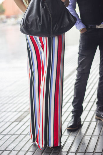 People Men Low Section Real People Standing Patriotism Flag Footpath Day Focus On Foreground Lifestyles Human Leg Human Body Part City Body Part Outdoors Striped Incidental People Clothing