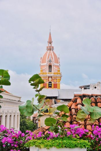If there is a roof top, there is a hidden gem. Building Exterior Architecture Built Structure Religion Place Of Worship Colorful Colombia Cartagena Urbanity City View  View From A Rooftop Color Colorful City Church Chapel Catholic Church