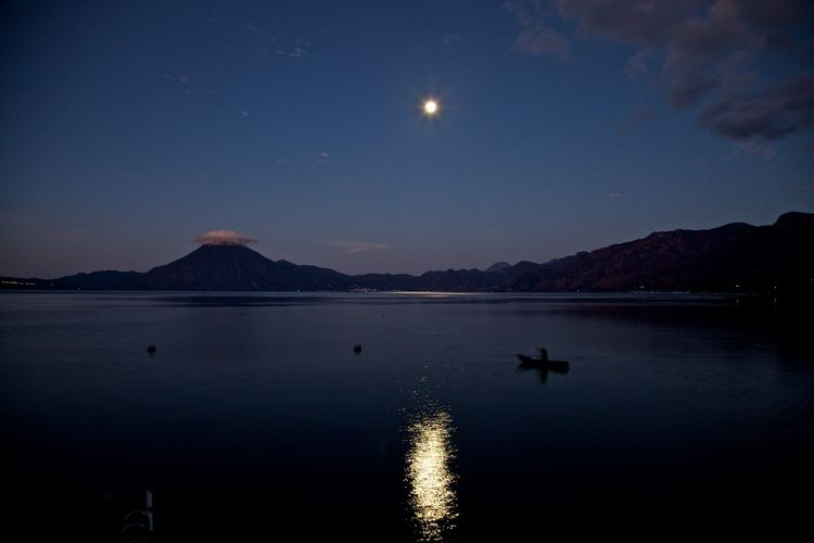 Moon over my dream Guatemala 🇬🇹 Moonlight Dusk Outdoors Silhouette Space Waterfront No People Lake Full Moon Night Tranquil Scene Scenics - Nature Mountain Nature Tranquility Reflection Beauty In Nature Moon Water Sky Atitlan Lake Night Lights Nightphotography