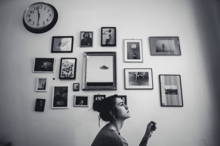 Portrait of woman against wall at home