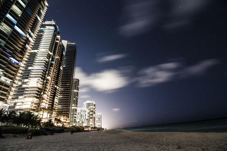 Architecture City Coastline Full Moon Lights Beach Building Exterior Buildings City Clouds Night Outdoors Sky Stars Starscape