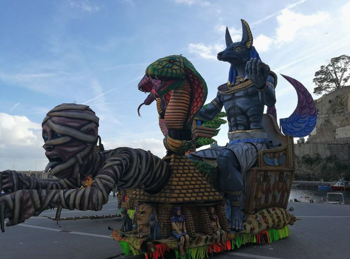 Maiori, Campania, Italy - March 4, 2019: Allegorical floats in the square of the port for the 46th edition of the Grand Carnival of Maiori Italy Campania Salerno Italy Grand Carnival Of Maiori Amalfi Coast Colorful Floats Carnival - Celebration Event Allegorical Floats Maiori, Day Art And Craft Representation Sky Creativity Human Representation Craft Nature Cloud - Sky No People Male Likeness Architecture Dragon Outdoors Warm Clothing