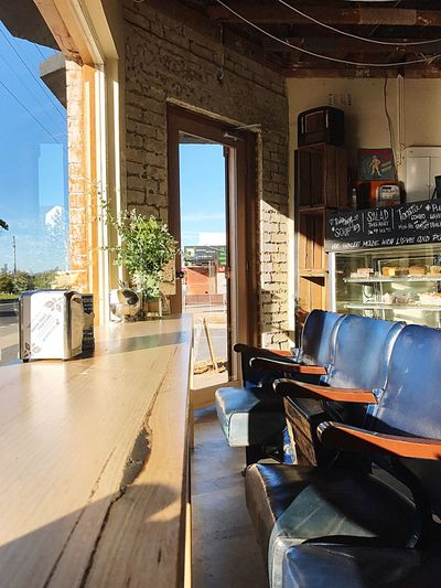 Best Seat in the House Weekend Sunday Summer Australia Mornington Peninsula RYE Beach Cafe Coffee EyeEm Selects Sunlight Architecture Indoors  Built Structure No People Day Window Seat Chair Door Entrance Furniture Table