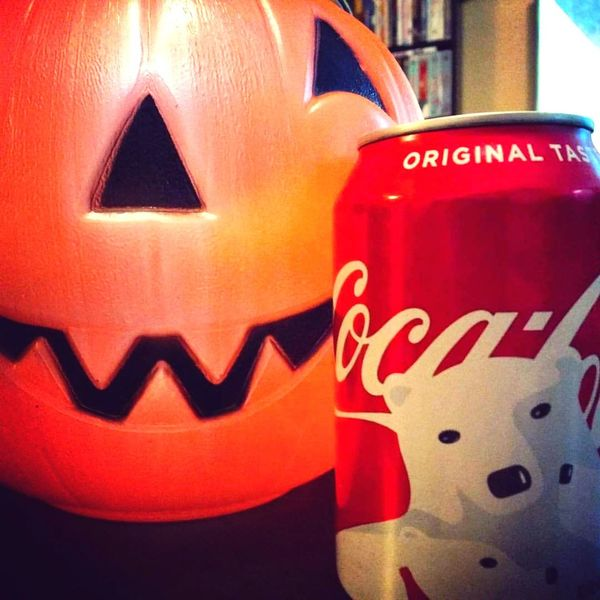 Plastic Halloween pumpkin and Christmas Coca Cola can. November 1, 2017. Halloween Christmas Christmas Season Nightmare Before Christmas Overlap Holidays Jack O' Lantern Plastic Pumpkin Pumpkin Coca Cola Coke Can Polar Bear Christmas Can Too Soon November 1st November Day After