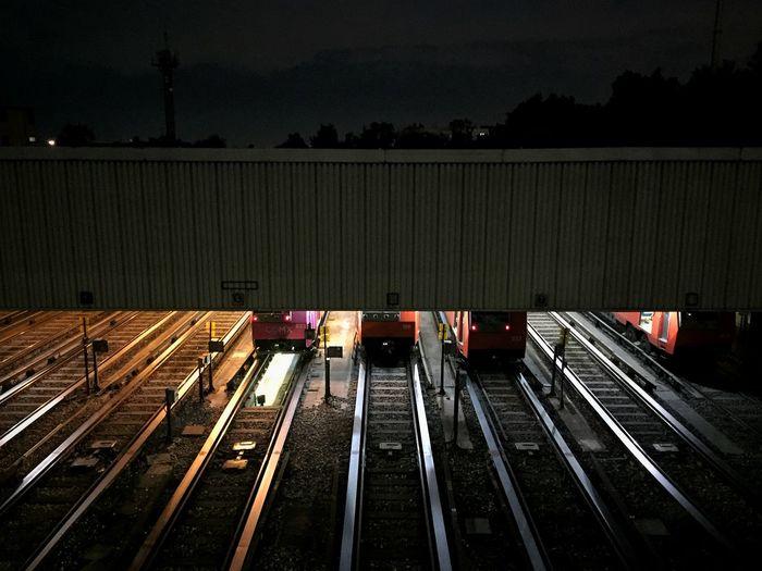 Bridge over railroad track at night