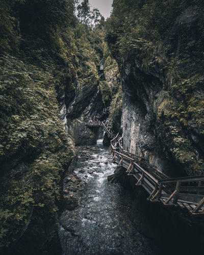 Scenic view of bridge amidst rock formation