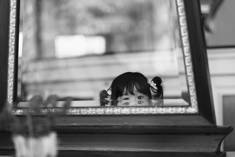 Portrait Of Girl Looking Hiding